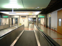 London Gatwick Airport - Moving sidewalks at the Gatwick Airport outside London England - by Ron Coates