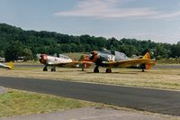 Sussex Airport (FWN) - North American T-6 and SNJ at the 1993 Sussex Air Show, Sussex, NJ  - by scotch-canadian