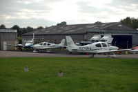 Gloucestershire Airport, Staverton, England United Kingdom (EGBJ) - Two Cirrus SR22s at Staverton Gloucestershire airport, England. - by Henk van Capelle