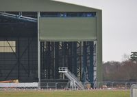 Bournemouth Airport, Bournemouth, England United Kingdom (EGHH) - Interesting door type on new hangar extensions. - by John Coates