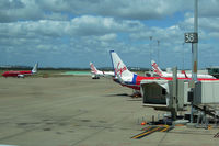 Brisbane International Airport, Brisbane, Queensland Australia (YBBN) - Old Virgin Blue and new Virgin Australia liveries - by Micha Lueck