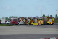 Norwich International Airport, Norwich, England United Kingdom (EGSH) - Fire engines lined up after a KLM 737 diverted to Norwich following a problem on a flight from Manchester to Amsterdam. - by Graham Reeve