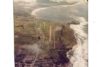 Half Moon Bay Airport (HAF) - Half Moon Bay airport in 1976 looking south. Notice the half moon shape water south of airport.Princeton at south end of airport (aircraft parking) is a very nice place to visit & eat at.Was my home base for six months till summer fog became untenable!! - by S B J