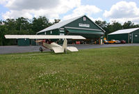Merritt Field Airport (4PN7) - Merritt Field, located in beautiful Sullivan County, PA, is home to the Eagle's Mere Air Museum, which uses most of the hangar buildings and owns the beautiful little Pietenpol Aircamper in the foreground. - by Daniel L. Berek