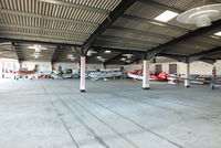 Goodwood Airfield - inside the main hangar at Goodwood - by Chris Hall