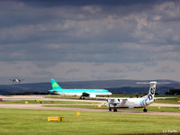 Manchester Airport, Manchester, England United Kingdom (EGCC) - Busy scene at Manchester EGCC with storm looming in the background. - by Clive Pattle