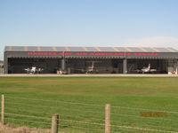 Napier Airport - air ambulance hangar visible from layby on main road - by magnaman