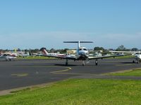 Moorabbin Airport - General shot of passenger tarmac at Moorabbin, with aicraft parking in the background. - by red750