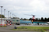 Dundee Airport, Dundee, Scotland United Kingdom (EGPN) - Eastwards facing shot of the apron at Dundee EGPN with a Northern Lighthouse EC135 (G-CGPI) hovering to land. - by Clive Pattle