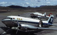 Port Moresby/Jackson International Airport - A trio of Douglas DC-3's at Port Moresby Airport, each in a different color scheme. This was the transition period for the newly formed Air Nuigini. Photo taken December 1974 - by Peter Lea