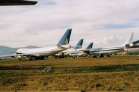 Mojave Airport (MHV) - Aircraft at Mojave storage. N17025 is the nearest 747. A 1973 747 238B. - by S B J