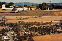 Round Valley Airport (O09) - The Round Valley airport ramp and air view of the small town of Covelo which is a short distance away.This was in 1992.The ramp view is looking toward town or east and town view is to the north. - by S B J