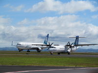 Auckland International Airport, Auckland New Zealand (NZAA) - ZK-NCJ and ZK-MCU racing along taxyway - by magnaman