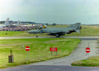 RAF Leuchars Airport, Leuchars, Scotland United Kingdom (EGQL) - Posted to primarily show a shot of the crowd line at a Leuchars Airshow. A sight that will be seen no more with the imminent closure as an airbase approaching fast (Mar '15). Taken at the 1996 airshow as a Luftwaffe Phantom F4F taxies in after a display. - by Clive Pattle