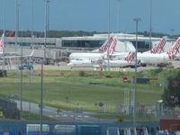 Brisbane International Airport, Brisbane, Queensland Australia (YBBN) - lots of virgins at domestic terminal - viewed from international terminal. - by magnaman