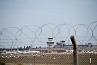 Tegel International Airport (closing in 2011), Berlin Germany (EDDT) - View thru the fence to apron.... - by Holger Zengler