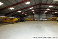 Oaksey Park Airport - one of the hangars at Oaksey Park - by Chris Hall