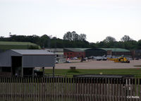 RAF Leuchars - A long distance shot of the ramp showing Typhoons and a Seaking - by Clive Pattle