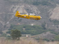 Santa Paula Airport (SZP) - Condor Squadron high speed flour bomb run at riverbed target, Commemorating 7 Dec. 1941 attack on Pearl Harbor. Bombardier always operating from back seat, making multiple passes/drops.  - by Doug Robertson