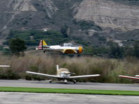 Santa Paula Airport (SZP) - Condor Squadron making another high speed flour bombing pass at riverbed target Commemorating the 7 Dec. 1941 attack on Pearl Harbor. - by Doug Robertson