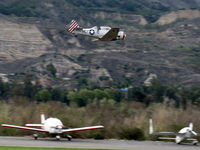Santa Paula Airport (SZP) - Condor Squadron making another high speed pass flour bombing the riverbed target Commemorating the 7 Dec. 1941 attack on Pearl Harbor. - by Doug Robertson