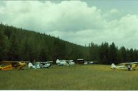 Spotted Bear /usfs/ Airport (8U4) - Spotted Bear with view to the NW. This is the main camping and tiedown area.The truck seen behind my Piper Colt, was for transportation to the near by lodge.Yes indeed, it was nice for these taildragger pilots to let me fly along. - by S B J