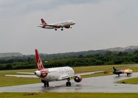 Edinburgh Airport, Edinburgh, Scotland United Kingdom (EGPH) - Virgin A320-214 EI-DEO Landing runway 06 while Virgin A320 EI-EZW And Hunter G-PSST Hold  - by Mike stanners