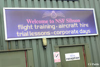 Peterborough/Sibson Airport - Some hangar signage at Sibson EGSP - by Clive Pattle