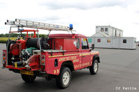 Turweston Aerodrome Airport, Turweston, England United Kingdom (EGBT) - The Fire Rescue Landrover at Turweston airfield with the temporary 'portacabin' ATC and Cafe accommodation in the background. - by Clive Pattle