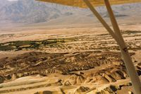 Furnace Creek Airport (L06) - Furnace Creek looking to the SW. Airport is seen at the top of the wing strut. - by S B J