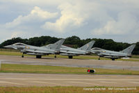 RAF Coningsby - ZJ937, ZJ805 and ZJ919 lining up on the runway at RAF Coningsby - by Chris Hall