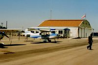 Los Banos Municipal Airport (LSN) - Good picture of the airport office and large hangar next to it. - by S B J