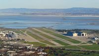 Moffett Federal Afld Airport (NUQ) - Flying over Moffett Federal Airfield, Mountain View, CA with the Blue Angels parked on the left side of the image. - by Chris Leipelt