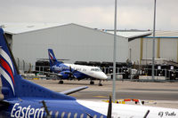 Aberdeen Airport, Aberdeen, Scotland United Kingdom (EGPD) - Eastern Airways apron at Aberdeen EGPD viewed from the multi-storey car park, charging 12p per minute to park there ! - by Clive Pattle