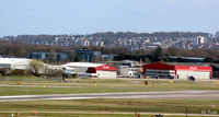 Aberdeen Airport, Aberdeen, Scotland United Kingdom (EGPD) - Bond Helicopters hangars at Aberdeen EGPD - with GA park on left of apron. - by Clive Pattle