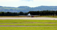 Dundee Airport, Dundee, Scotland United Kingdom (EGPN) - Facing east at Dundee with one of the new Aquila training aircraft of Tayside Aviation carrying pre-flight checks. - by Clive Pattle