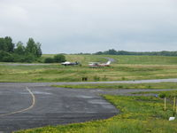 Schenectady County Airport (SCH) - civilian side of the airport, near the museum - by olivier Cortot