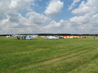 White Waltham Airfield - oldies out on the apron - as well as planes! - by magnaman