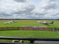 Sleap Airfield - grass apron in front of tower/cafe - by magnaman