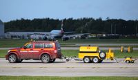 Manchester Airport, Manchester, England United Kingdom (EGCC) - Runway calibration vehicle at Manchester - by Guitarist