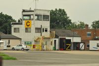 Fairoaks Airport - CONTROL TOWER 'Follow me' Mercedes in front of the building - by Sewell01