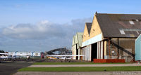 Blackpool International Airport, Blackpool, England United Kingdom (EGNH) - North side apron and hangars at Blackpool EGNH - by Clive Pattle