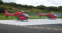 NONE Airport - The two Wales Air Ambulance helicopters (G-HEMN and G-WASN) at their new base at Dafen, Llanelli, Wales UK. - by Roger Winser