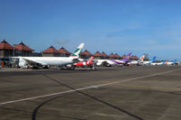 Ngurah Rai Airport (Bali International Airport) - Denpasar has become quite a busy airport: After holding for 30 minutes we finally landed, just to sit on the tarmac for another 30 minutes waiting for a gate to be available. My colleague experienced the same next day... - by Micha Lueck