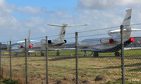 Dundee Airport, Dundee, Scotland United Kingdom (EGPN) - Through the fence - Bizjets parked up on the taxyway at Dundee Riverside Airport EGPN for the Annual Dunhill Golf Championships, held at nearby St Andrews.  - by Clive Pattle