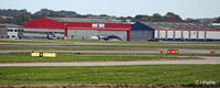 Aberdeen Airport - The Bond Helicopters hangar at ABZ has now lost its titles and now displays the 'Babcock MCS' signs - by Clive Pattle