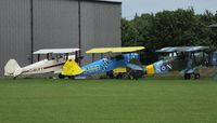 Fowlmere Airport - visiting aircraft parked beside the hangar - by Keith Sowter