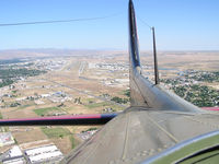 Boise Air Terminal/gowen Fld Airport (BOI) - Looking back at runways 10R & 10L from the radio compartment of a B-17. We have just taken off from RWY 28R. - by Gerald Howard