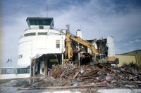 Great Falls International Airport (GTF) - Old GTF Terminal demolition, late 1990's. A restaurant called Victors once stood in the foreground attached to the terminal building. It disappeared in the 80's? - by Jim Hellinger