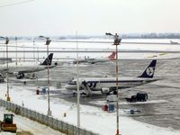 Warsaw Frederic Chopin Airport (formerly Okecie International Airport) - View in the snow from the public viewing area - by Keith Sowter